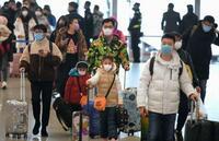 マスク姿で大挙日本へ、春節初日