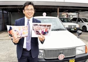 40万本分以上のワクチン寄付を達成したタクシーグループの筒井基好社長=福井市の福井都タクシー