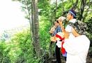 越知山山頂でホラ貝吹き修験者気分