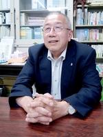 「認知症の人の居場所を確保する受け皿が必要」と訴える鈴木森夫代表理事=5月、京都府京都市