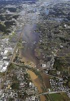 記録的な大雨により浸水した千葉県茂原市=10月26日午前9時41分(共同通信社ヘリから)