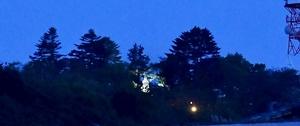 ライトアップされた継体天皇像(中央)=4月28日夜、福井県福井市有楽町