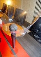 スナックで使われているマイク専用のシールド。歌うたびに消毒液を使って拭いている=福井県福井市の片町