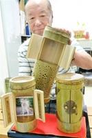 竹製のペット供養厨子を商品化した小林信夫代表=福井県福井市照手2丁目の小林金具工藝舎