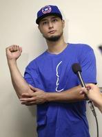 右肘の状態について話すカブスのダルビッシュ=8月19日、米サウスベンド(共同)