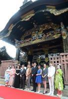 京都国際映画祭が開幕し、西本願寺の唐門前で記念写真に納まる出演者や映画関係者ら=12日午後、京都市