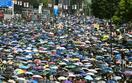 香港、マスク姿で再びデモ